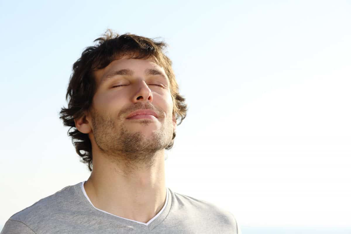 Attractive,Man,Breathing,Outdoor,With,The,Sky,In,The,Background