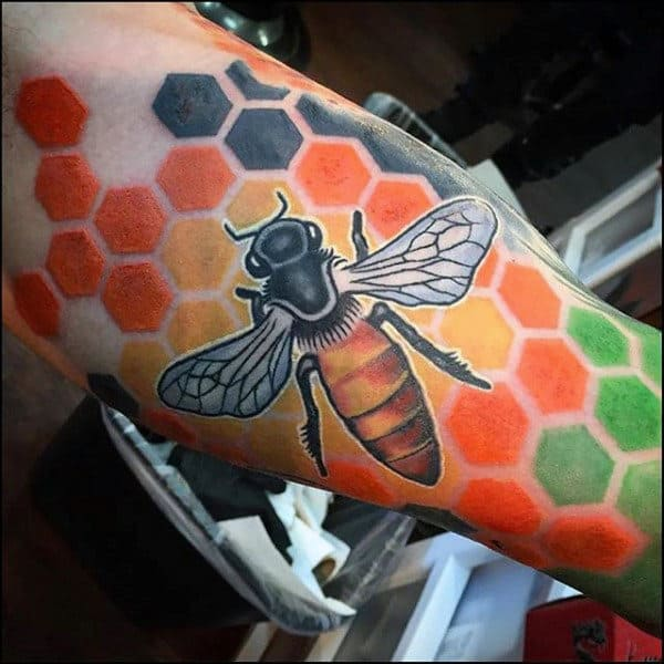 Huge Bee On Top Of Colorful Honeycomb Tattoo