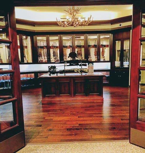 Huge Collectors Gun Room Inspiration With Antler Chandelier Decor