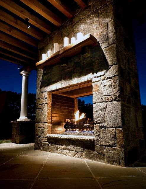 Huge Outdoor Stone Fireplace Design On Side Of Home