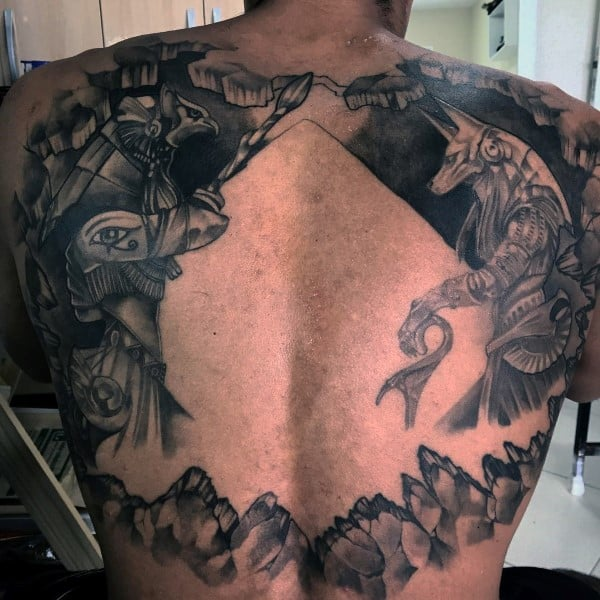 Huge Pyramid Negative Space Guys Anubis Tattoo On Back