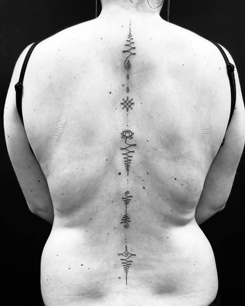 Huge Spine Unalome Tattoo
