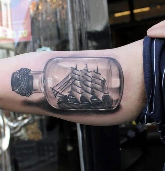 Incredible 3d Realistic Ship In A Bottle Tattoos For Men On Bicep Of Arm