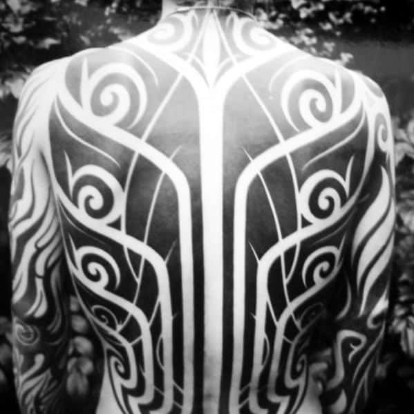 Incredible Awesome Tribal Negative Space Tattoos For Men