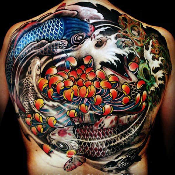 Incredible Back Yin Yang Fish Tattoo On Guy