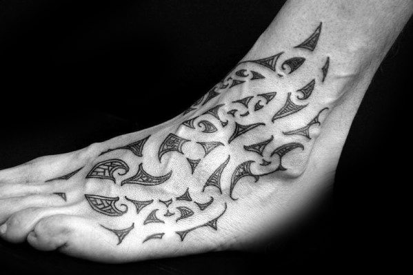 Incredible Negative Space Guys Hawaiian Tribal Tattoos On Foot