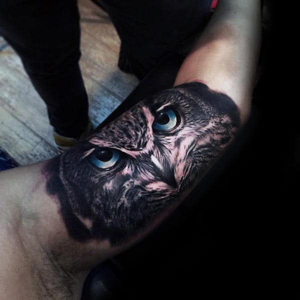 Incredible Realistic Inner Arm Bicep Male Owl With Blue Eyes Tattoo
