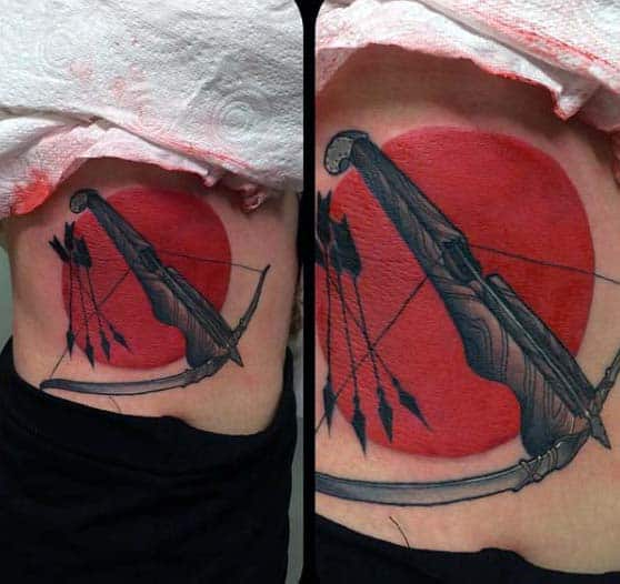 Incredible Red Bow And Arrow Mens Archery Tattoo Design On Lower Rib Cage Side