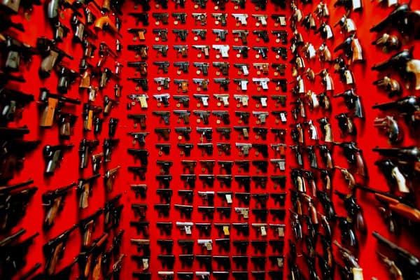 Incredible Room With Wall Mounted Pistols And Red Paint