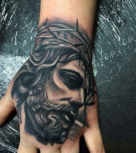 Incredible Shaded Mens Hand Tattoo Of Jesus Christ With Thorn Crown