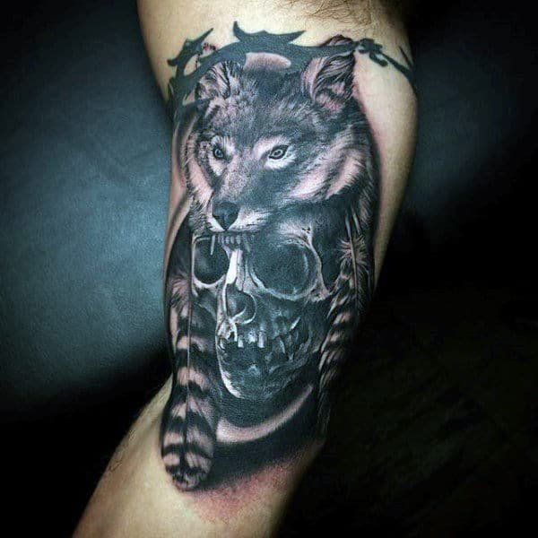 Indian Wolf And Feather With Skull Tattoo On Legs For Males