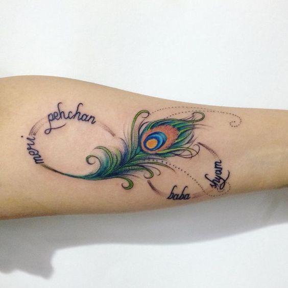 Tatouage plume de paon bras Infiniiti