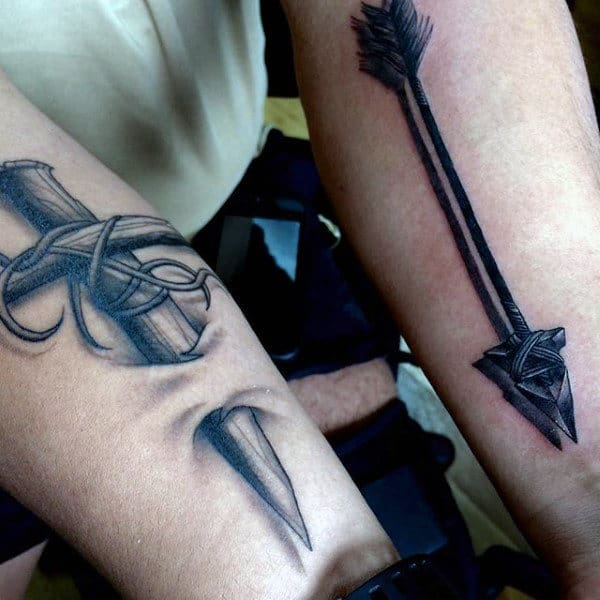 Inky Black Long Arrowhead With Shadow Effect Tattoo On Forearms Men