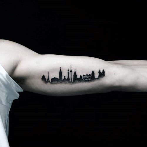 Inner Arm Bicep Male Skyline City Building Tattoo Design With Black Ink