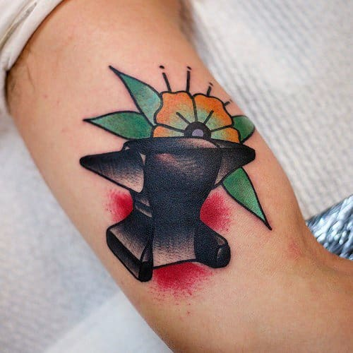 Inner Arm Bicep Male Tattoo With Anvil Design
