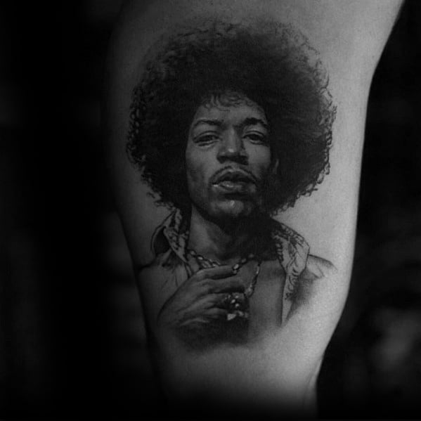 Inner Arm Bicep Portrait Tattoo Design On Man