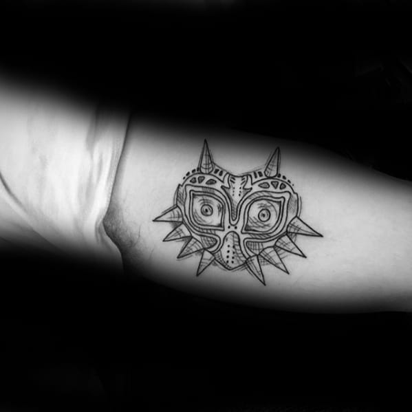 Inner Arm Black Ink Majoras Mask Tattoos For Gentlemen