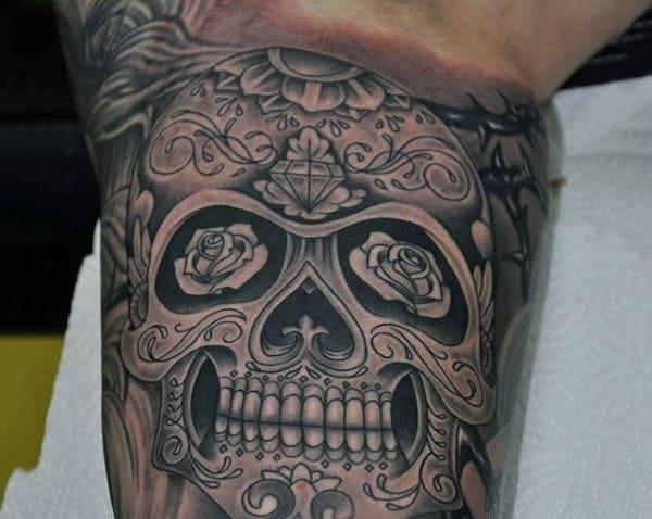 Inner Bicep Black And Grey Sugar Skull Male Tattoos