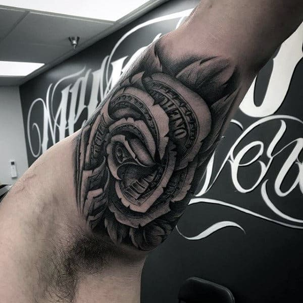 Inner Bicep Moeny Rose Flower Tattoo Design On Man