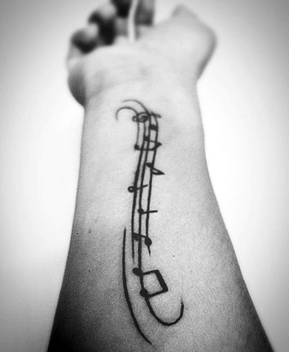 Inner Forearm Black Ink Simple Manly Music Staff Tattoo Design Ideas For Men