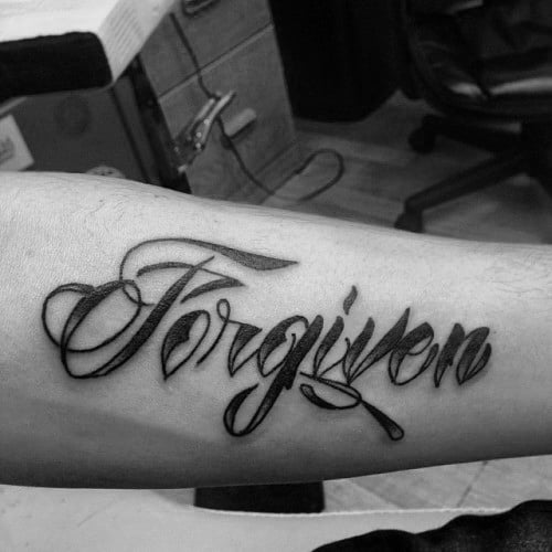 Inner Forearm Forgiven Black Ink Mens Word Tattoo