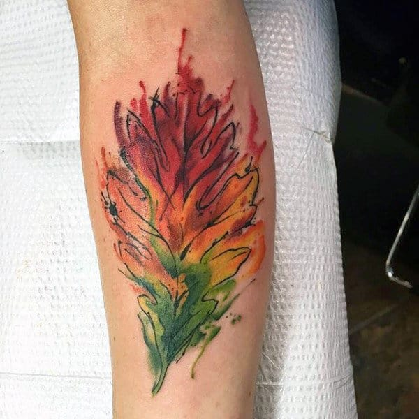 Inner Forearm Green Yellow And Red Man With Autumn Leaves Tattoo