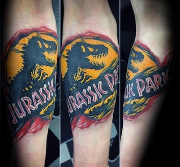 Inner Forearm Logo Male Jurassic Park Tattoo Design Inspiration