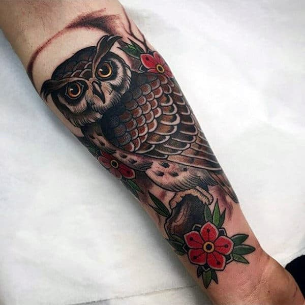 Inner Forearm Male Tattoo Of Traditional Owl And Red Flowers