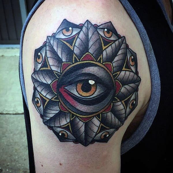 Innovative Nine Eyed Tattoo Mans Arms