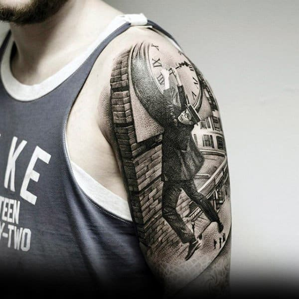 Interesting Tattoo Of Man Holiding On To Clock For Dear Life On Arm