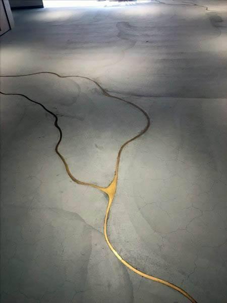 Interior Concrete Floor Ideas With Gold Filler In Cracks