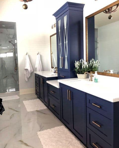 blue marble gold hardware countertop styling navy sconces vanity pin