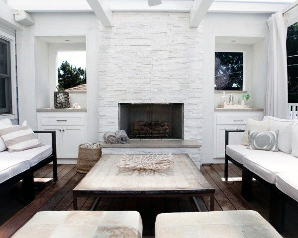 Interior Stacked Stone White Fireplace Design
