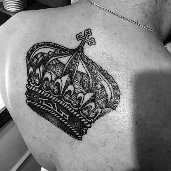 Intricately Designed Crown Tattoo On Back For Men