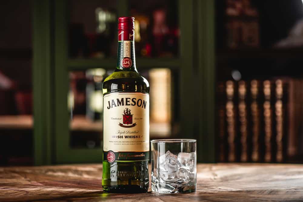 jameson whiskey with glass and ice cubes