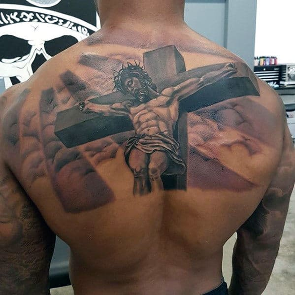 Jesus Cross With Clouds And Sun Rays Male Back Tattoo