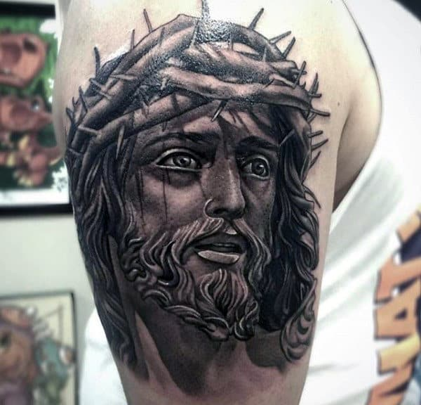 Jesus Face Male Upper Arm Tattoo With Black And Grey Ink