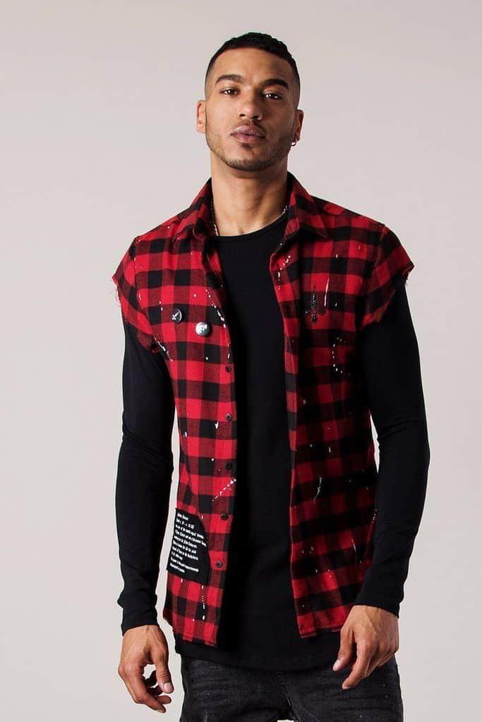 Man wearing oversized cut-off plaid shirt