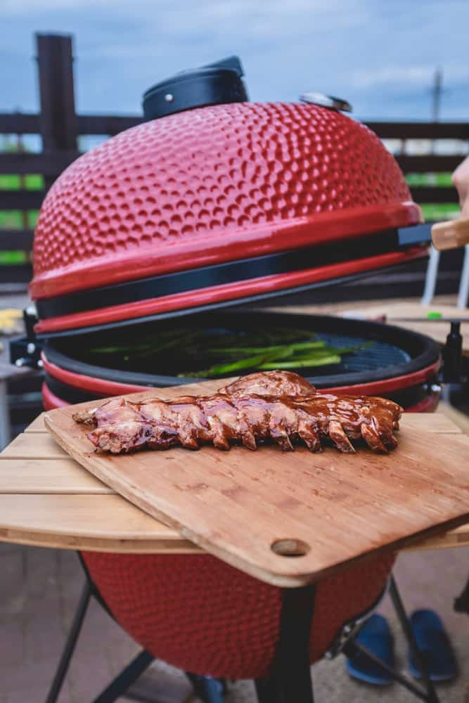 cooking meat with vegetables in kamado smoker