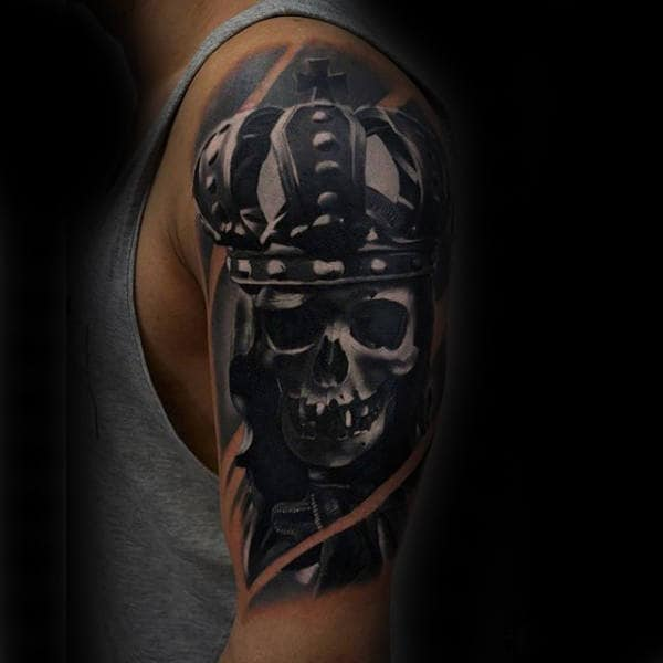 King Skeleton With Crown Black Ink Upper Arm Male Tattoo