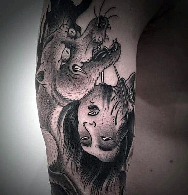 Kitsune Fox With Head By String Guys Arm Tattoo