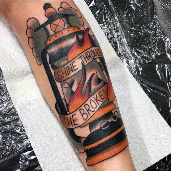 Lantern Shine Through The Broken Shin Tattoo On Man