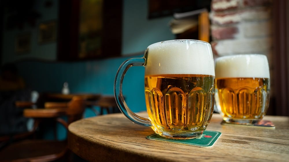 two large cup of beer on bar table
