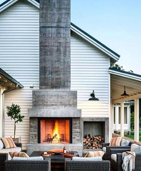Large Outdoor Grey Stone Cement Fireplace Design On Side Of House