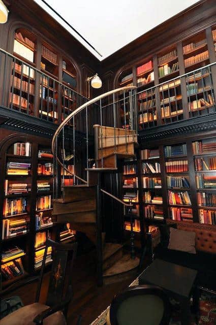 Large Spiral Staircase In Two Story Home Library