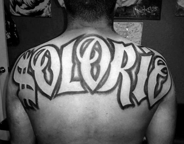 Large Upper Back Last Name Male Tattoo With Negative Space Lettering Deisgn