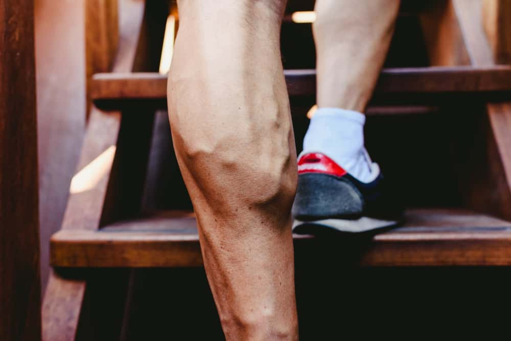 young man large visible veins of calf muscles