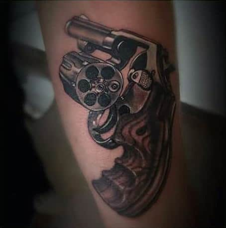 Last Bullet Remaining Pistol Tattoo On Elbows For Guys