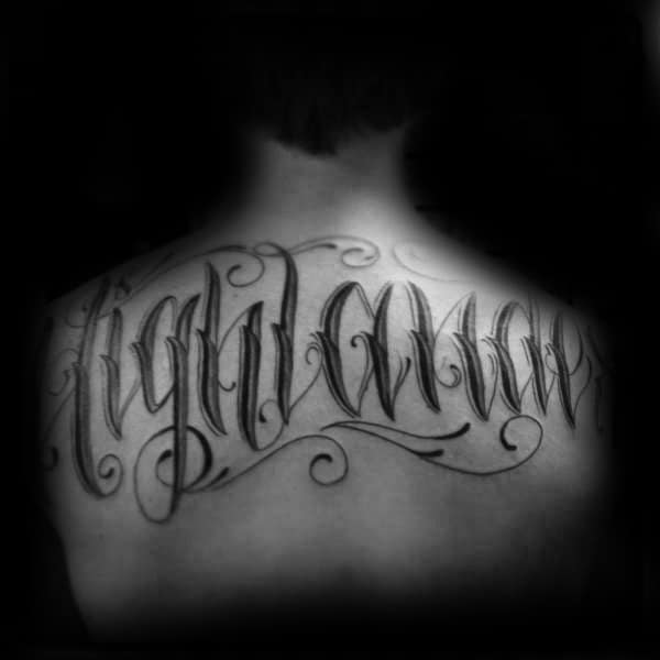 Last Name Script Male Black Ink Ornate Tattoo On Upper Back