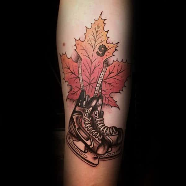 Leaf With Hockey Ice Skates Mens Inner Forearm Tattoo